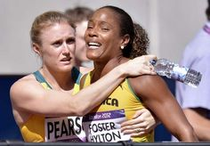 Jamaica's Brigitte Foster-Hylton is consoled by Australia's Sally Pearson after competing in a women's 100-meter hurdles heat during the athletics in the Olympic Stadium at the 2012 Summer Olympics, London, Monday, Aug. 6, 2012. / AP - http://www.PaulFDavis.com/success-speaker (info@PaulFDavis.com)
