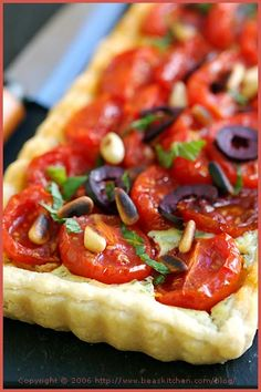 Cherry Tomato Tart with Garlic, Goat Cheese, Sage, Parsley, Olives, and Pine Nuts