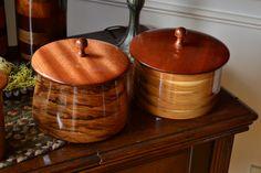 Hickory pots with mahogany lids.