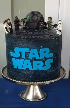 This Star Wars Cake is four layers of chocolate cake with cookies and cream filling. It is covered with dark blue Swiss Meringue Buttercream. The letters are gum paste, and the death star is cust… Bolo Star Wars, Star Wars Cake, Theme Star Wars, Star Wars Party, Fondant Flower Cake, Fondant Bow, Fondant Cakes, Fondant Tutorial, Chocolate Drip