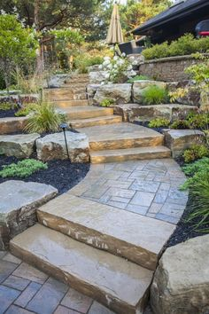 Back Yard Stone Pathway Oasis - Ravine Lot (or Sloping Lot) Worthy Design by Hogan Landscaping