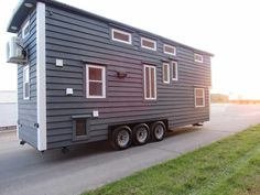 The Movie Star - Incredible Tiny Homes  Dropped axle for additional headroom.  Ladder for secondary loft is blocking access to the bathroom when out.  Has some good features.