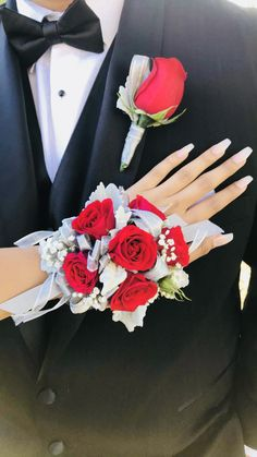 red home accents red home accents Prom wristband corsage and matching boutonniere featuring red roses, dusty miller and babys breath. Accented with silver satin and glitter ribbons! Prom Bouquet, Prom Corsage And Boutonniere, Red Rose Bouquet, Corsage Wedding, Corsage Formal, Wedding Bouquets, Red Corsages, White Corsage, Ideas