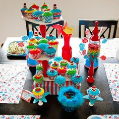 brightly colored dr. suess cupcakes and dessert table