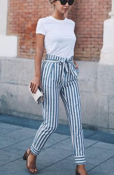 Pegged: trousers cut full in the waist and thigh area and cuffing at the ankles.Ready to wear. Budget.