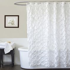 Gathered fabric clusters create a textured floral surface atop this white shower curtain from Lush Decor. Constructed of flowing tafetta, this charming shower curtain will lend dimension to any bathroom.