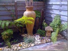 Image result for corner flower bed ideas