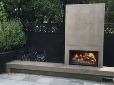 Outdoor Fireplace Patio, Concrete Fireplace, Concrete Wood, Small Courtyard Gardens, Small Courtyards, Chimney Cap, Concrete Finishes, Concrete Structure, Stainless Steel Doors