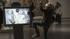 A museum designer explores interactive exhibits for the digital age
