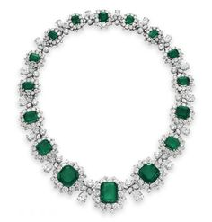 AN EMERALD AND DIAMOND NECKLACE, BY BVLGARI   Set with a graduated series of sixteen rectangular-cut and square-cut emeralds, each within a circular-cut diamond surround, spaced by graduated circular-cut, marquise-cut and pear-shaped diamond quatrefoils, mounted in platinum, 1962. Signed BVLGARI. Elizabeth Taylor collection