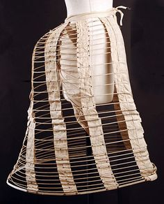 This was made in the 1870s. It is a bustle, which was used as an undergarment in order to create back fullness.