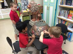 The Kindergarten Class painting our Fundraiser Auction Water Fountain Statue.