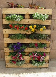 Pallets are cheap and easy to find. Make your vertical garden by closing it in with landscaping material, then just add soil and flowers!