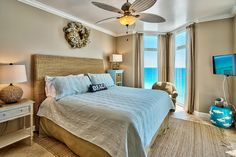 Beach bedroom in a Destin condo with lots of natural materials, including the headboard.