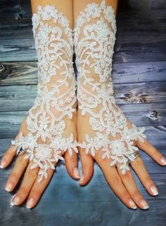 Hey, I found this really awesome Etsy listing at https://www.etsy.com/listing/222696378/white-long-lace-wedding-gloves-shiny