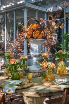 Love the combo of this orb on top of the urn! #Fall #Garden
