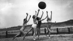 Four female vacationers playing with a ball in England in 1936.