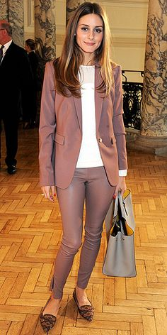 OLIVIA PALERMO We usually associate the color mauve with senior citizens' wardrobes. But grandma never wore mauve leather skinnies. And we're even okay with Olivia wearing the shade on top, too since she livens up the monochromatic ensemble with printed flats and a white top with a touch of sheer.
