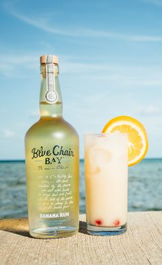 BOOZY BANANA COCKTAIL // 2 oz. Blue Chair Bay Banana Rum + 4 oz. pineapple juice + 1 oz. cream of coconut + 1 oz. orange juice // Add all ingredients in a shaker filled with a few ice cubes. Shake and strain into glass filled with ice. Garnish with cherry and orange wheel.