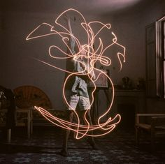 Pablo Picasso light paints a vase of flowers in 1949. Well before it was cool ... because he's Picasso.