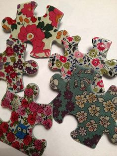 Use mod podge, puzzle pieces, and fabric to make interesting pins (SWAPs).