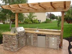 Small Outdoor Kitchen.  Really looks great-has everything you need so you don't have to leave guests to run back & forth in the house.