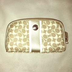 Coach make up bag It's tan and gold with a silver button purple lining on the inside good condition very few stains of make up on inside Coach Bags Cosmetic Bags & Cases