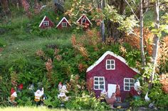 Iceland's otherworldly landscape makes a natural habitat for elves — or at least people who believe in them. Iceland Elves, Sloped Backyard Landscaping, Fairy Village, Gravel Garden, Private Garden, Island, Fairy Houses, The Elf, Outdoor Projects