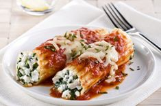Chicken, Cheese & Spinach Manicotti recipe-Take an Italian taste tour with our manicotti stuffed with chicken, basil, spinach and cheese. It's big on flavor and can even fit into your healthy eating plan. #healthylivingrecipes