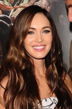 Megan Fox looks gorgeous with wavy, glossy locks and natural makeup.
