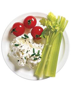 healthy snacks under 200 calories: half cup of low fat cottage cheese seasoned with chives and pepper w/ tomatoes and celery for  dipping
