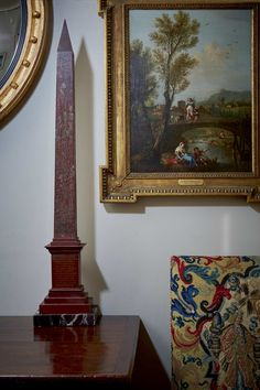 J.E Safra's Timeless Foyer with detail showing designer decorator David Hicks former possession : one of a pair of rosso antico marble Obelisks.