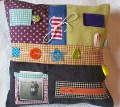 Sensory Cushion £39.99 4 patches of fabric - different textures. Buttons, ribbons and other objects to play with. Photographic sleeve.