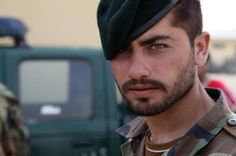 An Afghan National Army soldier looks at the camera during vehicle search training instructed by U.S. Soldiers at Combat Outpost Jaghato, Wardak province