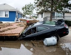 Here, a car sits crushed under debris after the hurricane ripped through Breezy Point, Queens, leaving a huge path of destruction. Survival Courses, Breezy Point, Path Of Destruction, Storm Surge, Queen Photos, Hurricane Sandy, Car Sit, Natural Disasters, East Coast