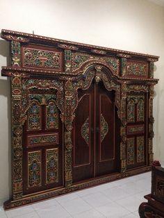 Hand carved wooden doors by Radja Pendapa.  Traditional Javanese carving  Www.radjapendapa.com