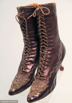 "Beaded boots c1900, Eggplant metallic leather, bronze metal beaded vamp in various designs including 5 stars over toe point, line of beaded scallops around boot, 20 pair eyelets, 2.75"" Louis heel, cream cotton twill lining, Augusta Auctions"