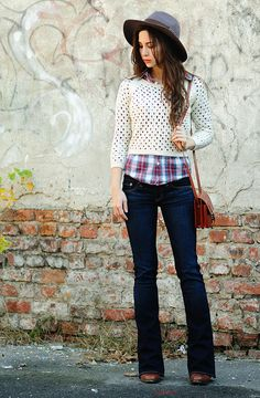 Great way to wear a cropped sweater! The bootcut jeans and plaid shirt ground this outfit, and the hat adds zing!