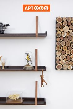 I love the combination of wood and leather. See these hanging Belt Shelves in the #APTCB2 Living Room Collection at www.cb2.com/APTCB2 #shelves #leather