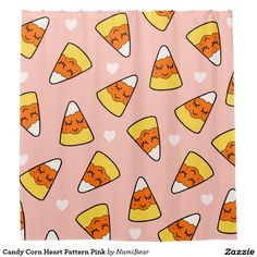 Candy Corn Heart Pattern Pink Shower Curtain by NamiBear on Zazzle.com. This is a drawing of a candy corn with a smile on her face with hearts around her. It has a pink background.