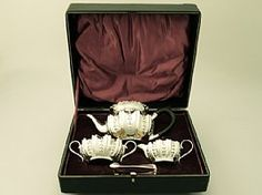A fine composite antique English sterling silver bachelor three piece tea service - boxed; an addition to our silver teaware collection