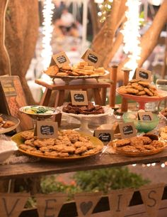 Cookies with little chalkboard signs on dessert bar.