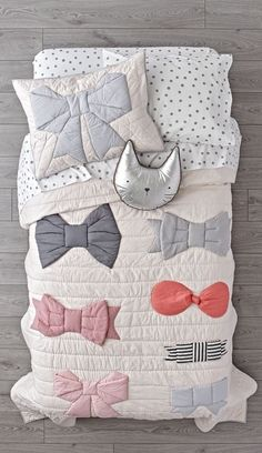 Shop Little Bow Bedding.  Our super comfy Little Bow Bedding is decorated with multicolored bows, all delicately embroidered and appliqued onto 100% cotton.