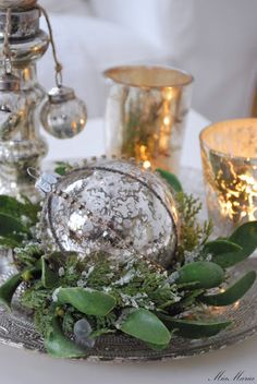 Mercury glass and greenery makes the holidays festive.