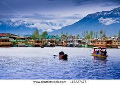 SRINAGAR, INDIA - April 15: Lifestyle in Dal lake,local people use 'Shikara', a small boat for transportation in the lake., April 15, 2012 in Srinagar, Kashmir, India - stock photo