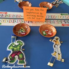 Free the superheroes by unlocking their padlock with the correct key - one less focus - EYFS.