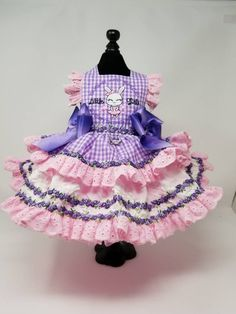 What are little girls made of? This is the first in my Nursery Rhyme Collection. Lavender gingham with machine embroidery. Beautiful high end trim with pink eyelet ruffles make your little girls dress a must have. The two petticoats add lots of volume. Custom sized to your