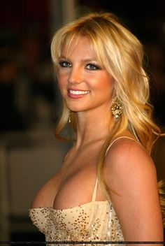 Britney Spears.....Is it just me or does anybody else look at this picture and wonder where the hell her nipples are located??