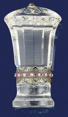 A rock crystal, diamond and gem desk seal  Of faceted balaster style the top decorated with a central collet-set cabochon sapphire within sapphire border, the central column with rose-cut diamond, ruby and enamel collar, the matrix engraved with a continental armorial, circa 1900