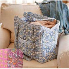 """This generously-sized tote makes the perfect weekend bag or carry-on. A padded shoulder strap offers extra comfort and pockets inside and outside the bag make organizing a snap. It's the perfect Tote to carry everything in style! 19""""l x 7 1/2""""w x 15""""h; 12"""" shoulder strap drop"""